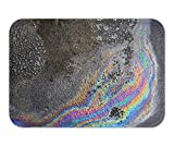 NasNew Doormat Oil Spill on Asphalt Road Background or Texture