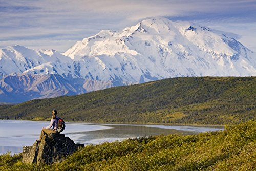 michael-deyoung-design-pics-hiker-sits-and-enjoys-a-view-of-wonder-lake-and-mt-mckinley-during-late-