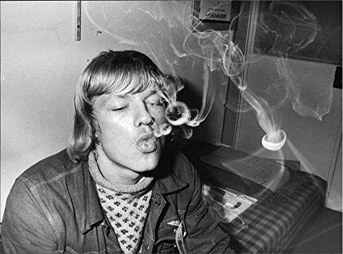 vintage-photo-of-jan-van-deurs-formann-record-breaking-branch-of-blowing-smoke-rings-in-large-number