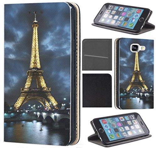 Samsung Galaxy J7 2017 J730 Hülle von CoverHeld Premium Flipcover Schutzhülle Flip Case Motiv (394 Eifelturm Paris Frankreich bei Nacht Blau Gelb)