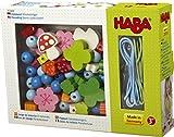 HABA 302636 - Fädelspiel Glücksbringer | Kreatives Fädelspielzeug mit Glücksbringer-Motiven | Set aus 2 Fädelschnüren, 30 Fädelelementen und 20 Perlen zum Auffädeln | Spielzeug ab 3 Jahren