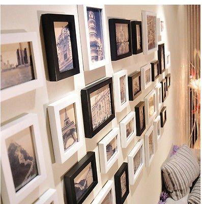Pacco da 8 solide cornici in legno per foto 10x15 nero for Cornici per foto in vetro