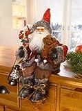 Statuetta di Babbo Natale seduto
