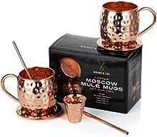 Juego de dos tazas de cobre para Moscow Mule Hechas a mano por Riches & Lee - Este set regalo 100% de cobre incluye: 2 tazas, 2 Posavasos, 2 Pajitas, 1 vasito medidor además de un ebook de recetas de cócteles