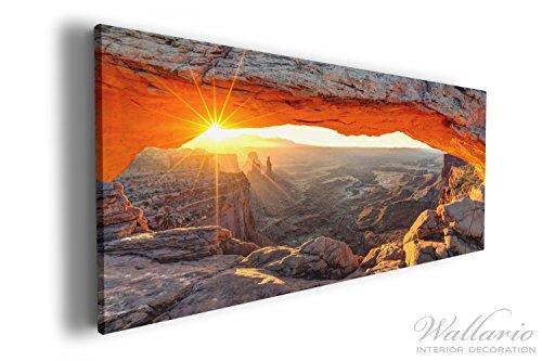 Wallario XXL Wallario Leinwandbild Sonnenstrahl am Horizont – Leuchtende Felsspalte - 60 x 150 cm...