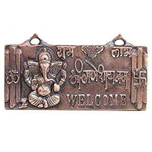 Welcome your guests into your home with this beautifully crafted door hanging. Made of gun metal the image of Ganeshji and other symbols are carved into it. Unique gift for your loved ones . Each piece is handcrafted and there maybe some vari...