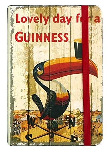 "Nostalgisches Guinness-Notizbuch mit ""Lovely Day for a Guinness""-Tukan auf Wetterfahne"