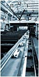 Wallario Design Wanduhr Fließband in Einer modernen Fabrik Halle mit Maschinen und Gitterdach aus Acrylglas, Größe 30 x 60 cm, Schwarze Zeiger