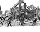 """Size Size of photo 10"""" x 8.1""""    Parts of Brixton looked like a war area after the riots.UK, England, Politics, elections, demonstrations, Labor, Tories, racial opposition, riots, street raid This photograph originates from the International Maga..."""