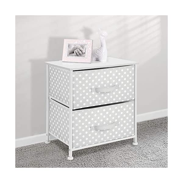 mDesign Chest of Drawers - Children's Bedroom Storage System with 2 Drawers and Flat Top - Nursery Storage Unit with Polka Dot Design - Grey/White mDesign SWEET STORAGE: This 2-drawer side table is a must-have accent to complement any child's room. The grey fabric is adorned with a sweet white polka dot pattern. STORE ANYTHING: The bedroom drawers are a versatile unit and can be filled with anything. Use to store toys, accessories, clothes, books, nappies and more. VERSATILE UNIT: Although the unit works best as bedroom storage, its uses do not stop there. Place in play rooms, nurseries and other child-specific areas of the home. 2