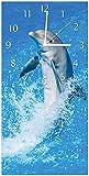 Wallario Design Wanduhr Fröhlicher Delfin im blauen Wasser aus Acrylglas, Größe 30 x 60 cm, weiße Zeiger