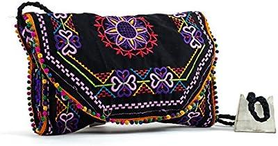 Gota de agua bolso etnico hecho a mano en tela y bordado con hilos de seda.