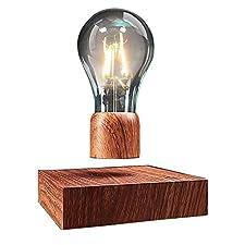 Die Glühbirne leviate und leuchten durch einfache, aber faszinierende Wissenschaft, die Levitation ist das Ergebnis der elektromagnetischen Kräfte zwischen der Basis und buld, die Glühbirne selbst wird durch Induktion angetrieben    Bitte überprüfen...