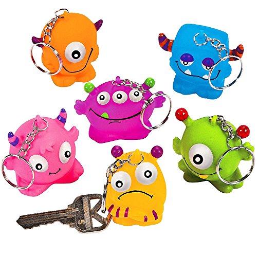 Preisvergleich Produktbild German Trendseller® - 8 x Bunte Nerdy Terdy Monster  Schlüsselanhänger 8 Monster Anhänger  Diese Monster werden dich ab nun auf deiner Reise begleiten