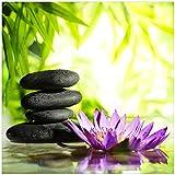 Wallario Sticker/Aufkleber für Kühlschrank/Geschirrspüler / Küchenschränke, Selbstklebende Folie - 60 x 60 cm, Motiv: Steinstapel in schwarz mit Blumenblüte in lila