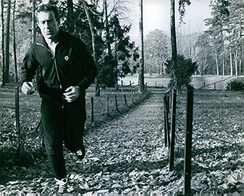 Vintage photo of Photo of Jean-Jacques Servan-Schreiber jogging alone in a park, January 25, 1968.