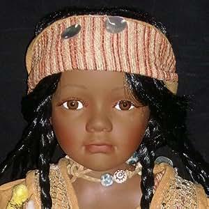 Jolie poupée en porcelaine noire Mubina édition limitée