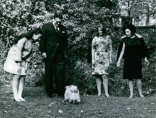 Vintage photo of The Grand Duke Wladimir with family in garden and playing with a dog.1968The Grand Duke Wladimir with family