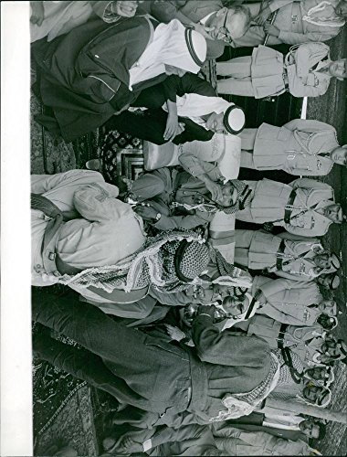 vintage-photo-of-jordanian-official-sitting-talking-and-drinking-surrounded-by-soldiers