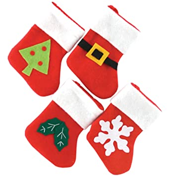 Set Of Four Baby Mini Christmas Stockings by Christmas Decorations ...