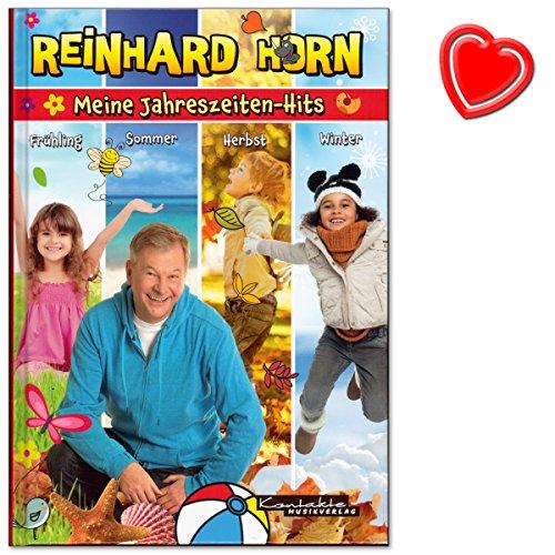 Buchcover Meine Jahreszeiten-Hits - Songbook von Reinhard Horn - mit 62 Liedern durch das Kalenderjahr - zu vielen Liedern gibt es Spiel-, Bewegungs- und Tanzideen - Buch mit mit bunter herzförmiger Notenklammer