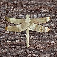Broche libélula mujer en color dorado.
