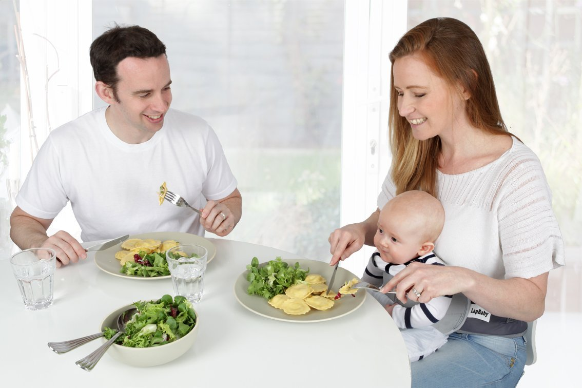LapBaby: Hands-free babywearing highchair, baby harness and weaning aid. LapBaby Designed in the UK, LapBaby is a hands-free belt that comfortably secures a baby in an adults' lap leaving both hands free to eat, work, read/wean/play with baby or engage with another child. Suitable for use from 3 months old  (before high chair age), LapBaby is soft and gentle on your baby's sensitive skin, made from materials that are free from harmful chemicals and allergens. LapBaby is light and portable so not only a baby essential at home, it's perfect for travel especially cafes, aeroplanes and trains 7
