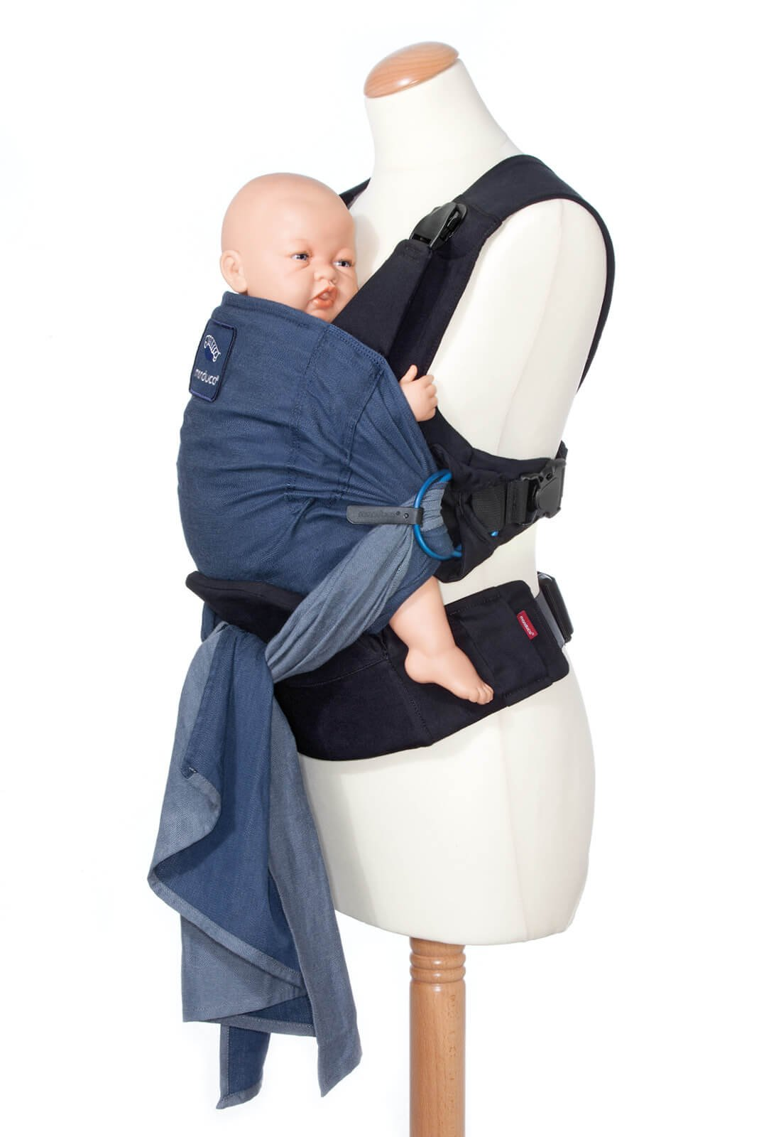 manduca Duo - Hybrid of Baby Carrier and Sling, Innovative Click &Tie System, Baby Slip-Through-Protection, Removable Hip Belt, Organic Cotton and Mesh, from Birth to 15kg (Blue) Manduca Optimized as front carrier, with slip-through protection (secure fit for your baby), supports the M position, for newborns from birth to infants up to 15 kg Especially popular with first-time parents who find it difficult to choose between a sling and a comfort carrier with buckles. Easy to use, illustrated instructions Detachable hip belt, which is only zipped on when needed (up to 140cm circumference without belt extension). Ideal for mothers with sensitive belly and after cesarean section, good weight distribution, comfortable on the shoulders. 6