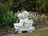 Magnifique statue de fille sur un banc en pierre de fonte, résistant au gel