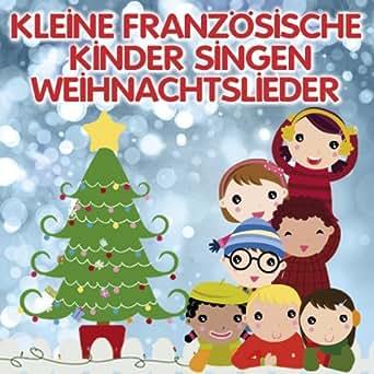 Kleine französische Kinder singen Weihnachtslieder von