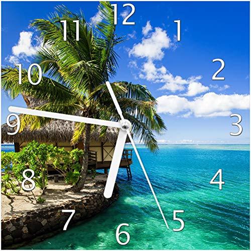 Wallario Glas-Uhr Echtglas Wanduhr Motivuhr; in Premium-Qualität; Größe: 20x20cm; Motiv: Karibisches Meer - Einsame Hütte unter Palmen