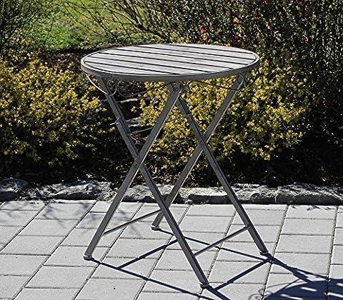 Table de bistrot en fer forgé et bois dans un