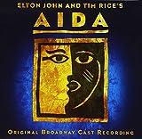 Songtexte von Elton John - Aida