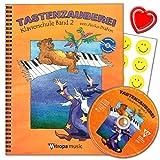 Tastenzauberei Band 2 - Klavierschule von Aniko Drabon. Schule für Einzel- und Gruppenunterricht in deutscher Sprache. CD zum Üben und Mitspielen, 7 lustige Smiley-Sticker , herzförmiger Notenklammer. -