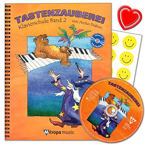 Tastenzauberei Band 2 - Klavierschule von Aniko Drabon. Schule für Einzel- und Gruppenunterricht in deutscher Sprache. CD zum Üben und Mitspielen, 7 lustige Smiley-Sticker , herzförmiger Notenklammer.