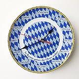 Geschenkbox GmbH Bayerische Rückwärtsuhr Wanduhr Rückläufige Uhr mit bayerischen Zahlen in Mundart, blau-weiße Raute, ø 19 cm