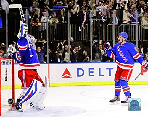 Henrik Lundqvist of the New York Rangers celebrates with his teammate Ryan McDonagh after defeating the Montreal Canadiens in Game Six to win the Eastern Conference Final of the 2014 NHL Stanley Cup Playoffs at Madison Square Garden on May 29 2014. Photo Print (50,80 x 60,96 cm)
