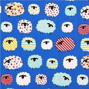 Tissu Oxford bleu avec des moutons rigolos par Kokka Japon