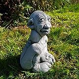 lustige Steinfigur der