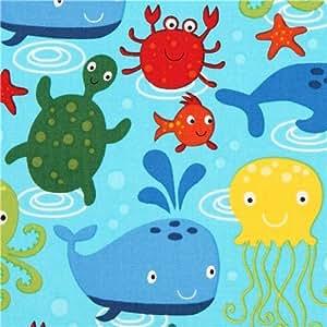 Tissu par Robert Kaufman bleu avec des animaux marins