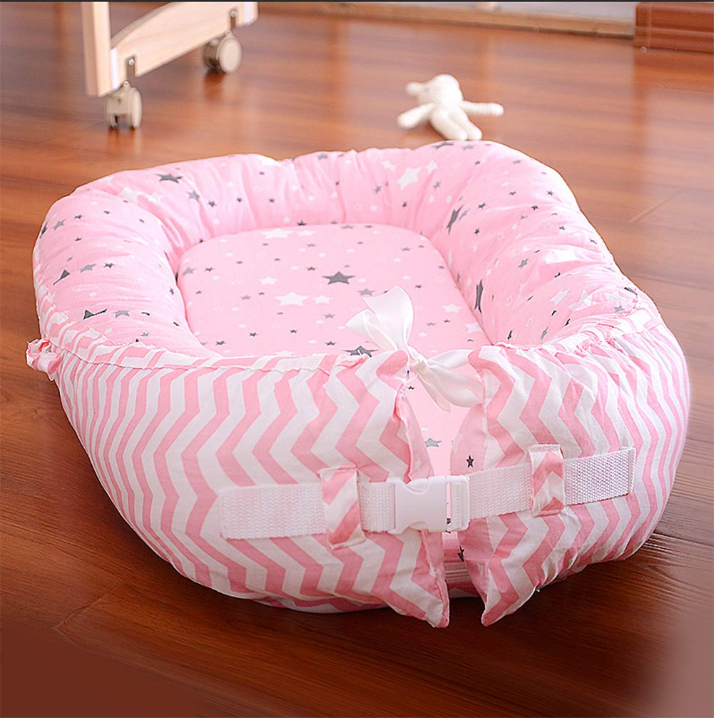 LNDD-Baby Nest Cushion Travel Bionic Uterine Bed Sleeping Pods Sleeping Bag Cotton Snuggle Suitable for Newborn Children From 0-18 Months,Pink LNDD ★COTTON FABRIC: This product is cotton fabric, surrounded by pp cotton padding, the bottom plate is a high-elastic sponge, which makes the small bed skin-friendly and better protects the baby's growth and development. ★IMITATION UTERUS DESIGN: 306° wrap around wraparound compact space as if in a familiar uterine environment, designed to sleep deeply throughout the night. ★RETRACTABLE DESIGN: 0-10 months to close the sleep Adjustable tightness helps to extend the sleep time in the middle of the night, 10-18 months to open the sleep to extend the use time to improve cost performance. 1