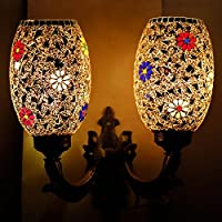 This dual dome glass wall lamp has been perfectly designed to lighten up your surroundings. Mosaic work all over the surface along with multicoloured flowers make this wall lamp appealing to your home. The impact is mesmerizing when lighted up with c...