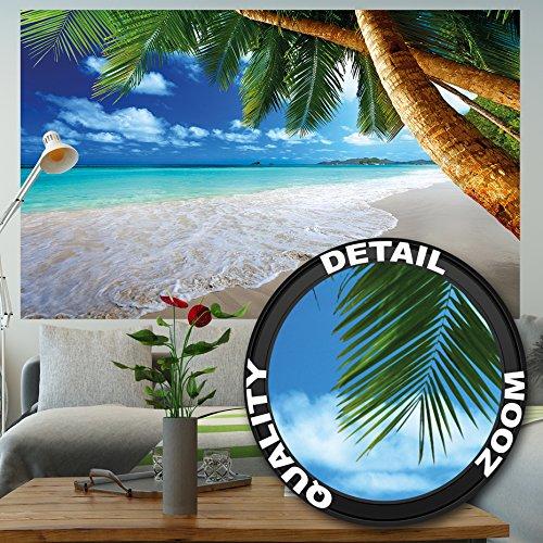 Papier peint photo Plage de sable avec des palmiers et la mer – Photo murale titrée: Plage paradisiaque - decoration murale XXL qui montre une plage by GREAT ART (210 cm x 140)