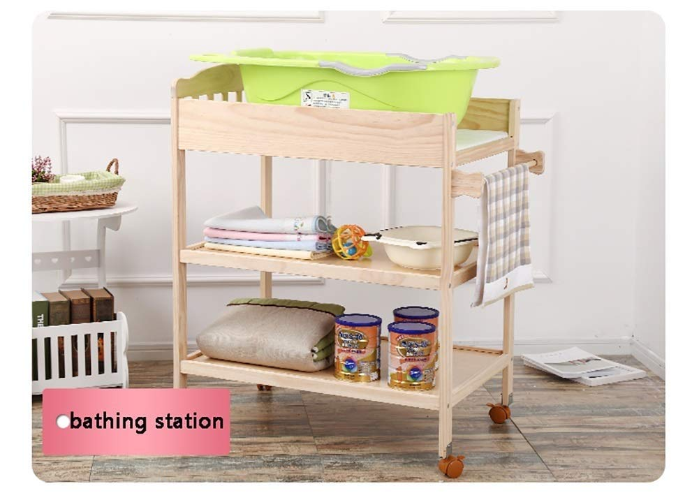 Changing Table Baby Changing Table Portable Wooden Newborn Massage Care Station Foldable Integrated Diaper Station Dresser (Color : Wood) Changing Table ●Size and Safe and Stable- 82×58×97cm/ 32×23×38 inch,Suitable for babies weighing less than 25kg,With seat belt,Changing pad has a restraining strap for added safety and is made of easy to clean, soft ●2-in-1 design- Baby changing table can be used as baby massaging table as well. It is designed at the proper height of parent to prevent mom's back aches and pains from kneeling or bending when changing diapers to babies. ●Premium materials - Using high-quality materials for our 2 in 1 infant changing table,Reinforced wood,it is durable and stable for long time daily use,And easy to clean and maintain. 4