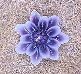 Vela nenufar.Vela flor. Vela flotante de jardín con forma de vela nenúfar, en color lila. La vela es de cera. Medidas de la vela flor nenúfar flotante 8,5 x 3 cm de alto
