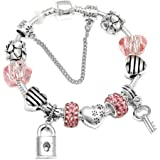A 925 silver bracelet adorned with beads and pandora elements and two earrings in the form of a lock and a key