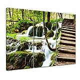 Bilderdepot24 Kunstdruck - Holzbrücke über einem Wasserfall - Bild auf Leinwand - 120x80 cm dreiteilig - Leinwandbilder - Bilder als Leinwanddruck - Wandbild