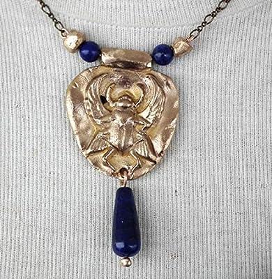collier, bijou ésotérique/Egyptien, scarabée en bronze couleur or/argent ou en cuivre orné de perles et goutte de lapis lazuli ou d'hématite couleur or avec lapis lazuli par défaut
