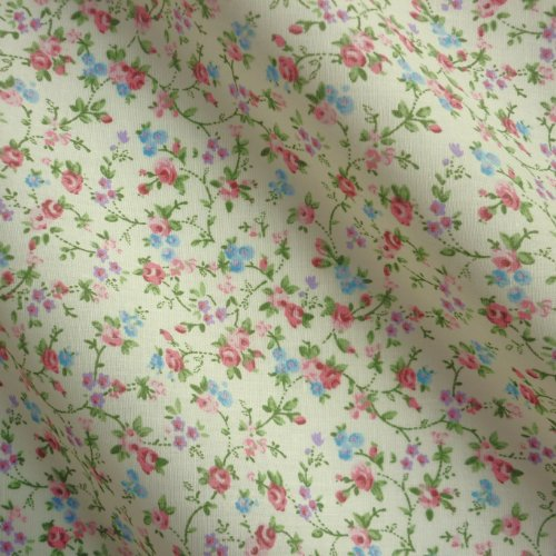 cream-tinted-polycotton-fabric-with-multi-rose-floral-print-per-metre