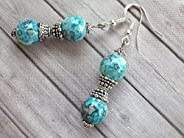 Boucles d'oreilles Thurcolas Blue Spirit en perles de jade blanc naturel teinté bleu et perles tibéta